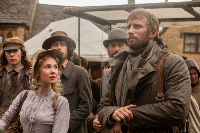 far-from-the-madding-crowd-gabriel-and-fanny-played-by-juno-temple-watch-as-soldiers-recruit-men